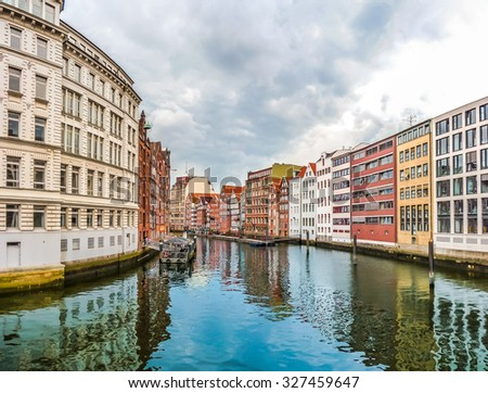 Beautiful view of colorful buildings and Nikolaifleet from famous Holzbrucke (so-called wooden bridge) in the Altstadt quarter of Hamburg, Germany - stock photo