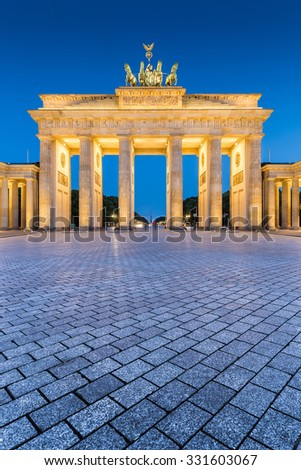 Beautiful view of famous Brandenburger Tor (Brandenburg Gate), one of the best-known landmarks and national symbols of Germany, in twilight during blue hour at dawn, Berlin, Germany - stock photo