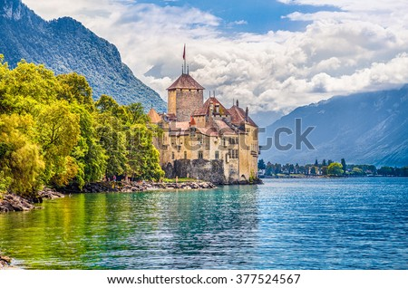 Beautiful view of famous Chateau de Chillon at Lake Geneva, one of Switzerland's major tourist attractions and most visited castles in Europe, with blue sky and clouds, Canton of Vaud, Switzerland - stock photo