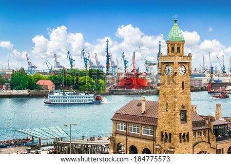 Beautiful view of famous Hamburger Landungsbruecken with harbor and traditional paddle steamer on Elbe river, St. Pauli district, Hamburg, Germany - stock photo