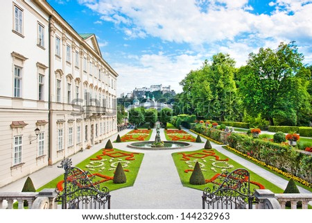 Beautiful view of famous Mirabell Gardens with Mirabell Palace and the old historic Fortress Hohensalzburg in the background in Salzburg, Austria - stock photo