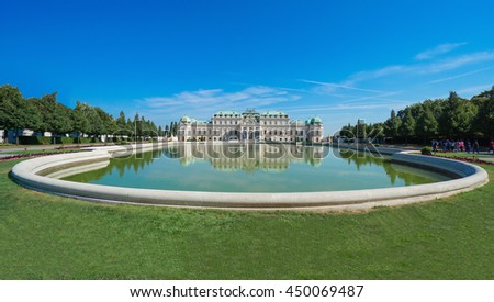 Beautiful view of famous Schloss Belvedere with a reflectant pool and blue sky, in Vienna, Austria - stock photo