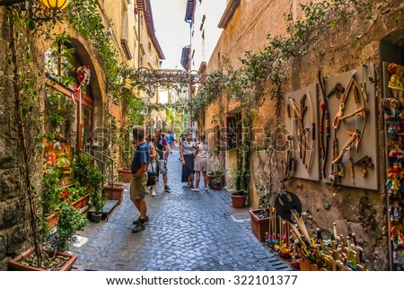 Beautiful view of frisky alley with ancient buildings at square near the Cathedral of Orvieto (Duomo di Orvieto), Umbria, Italy - stock photo