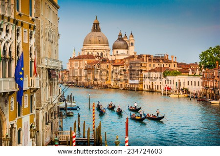 Beautiful view of Gondolas on famous Canal Grande with Basilica di Santa Maria della Salute at sunset in Venice, Italy - stock photo