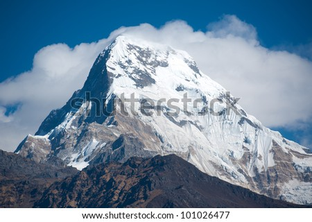 Beautiful view of Himalayan mountains with snow in morning when see from Ghorepani Village, Poon Hill Trekking way, Nepal - stock photo