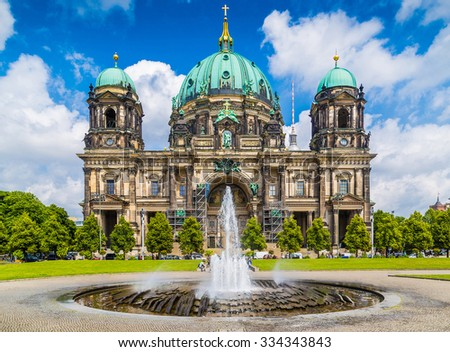 Beautiful view of historic Berlin Cathedral at Lustgarten park with famous TV tower in the background on a sunny day with blue sky and clouds in summer, Berlin Mitte district, Germany - stock photo