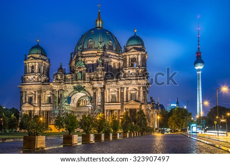 Beautiful view of historic Berlin Cathedral with famous TV tower in the background in twilight during blue hour at dusk, Berlin Mitte district, Germany - stock photo