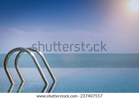 Beautiful view of Infinity Swimming Pool with sunlight - stock photo