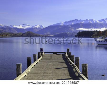 Beautiful View of Lake Wanaka and its jetty in autumn, Otago region, South Island, New Zealand. - stock photo