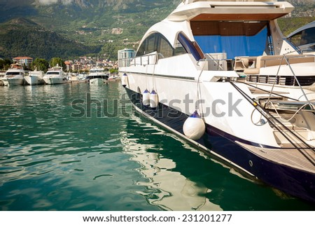 Beautiful view of luxurious white yacht moored at sea bay - stock photo