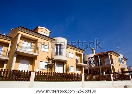 Beautiful view of modern holiday townhouses in Portugal - stock photo