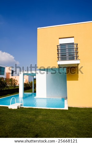 Beautiful view of modern holiday villa with swimming pool - stock photo