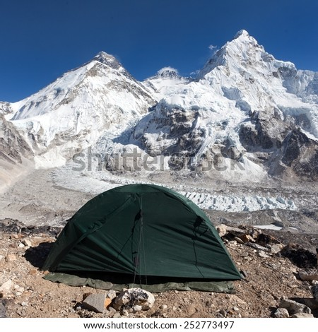 Beautiful view of mount Everest, Lhotse and nuptse from Pumo Ri base camp with green tent - way to Everest base camp - Sagarmatha national park - Nepal - stock photo