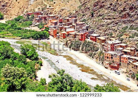 Beautiful view of mountains, river and a village (Atlas mountains, Morocco) - stock photo
