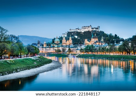 Beautiful view of Salzburg skyline with Festung Hohensalzburg and Salzach river at blue hour, Salzburger Land, Austria - stock photo