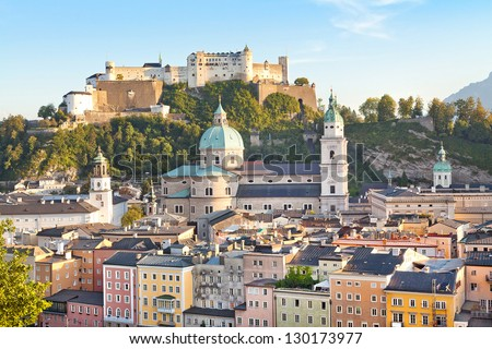 Beautiful view of Salzburg skyline with river Salzach at sunset as seen from Kapuzinerberg in Salzburg, Salzburger Land, Austria - stock photo