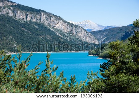 Beautiful view of St.Croix lake in Verdon and the mountains of Alpes-de-Haute-Provence. (Provence, France) - stock photo