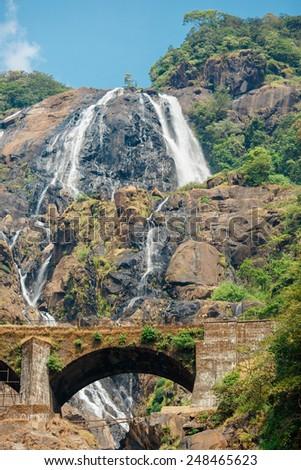 Beautiful view of the Dudhsagar waterfall and railroad bridge in Goa/India - stock photo