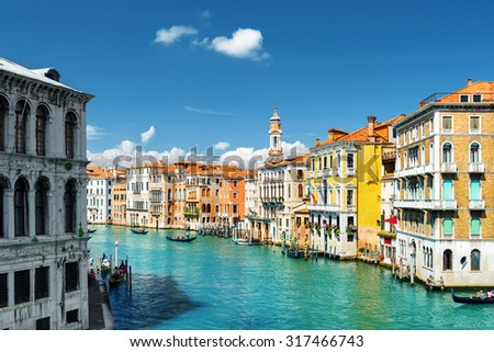 Beautiful view of the Grand Canal from the Rialto Bridge in Venice, Italy. Colorful facades of old medieval houses. Venice is a popular tourist destination of Europe. - stock photo