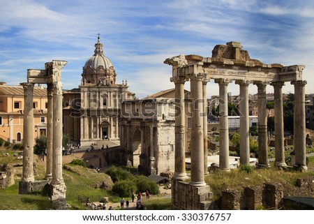 Beautiful view of The Roman Forum surrounded by the ruins of several important ancient government buildings at the center of the city of Rome, Italy - stock photo