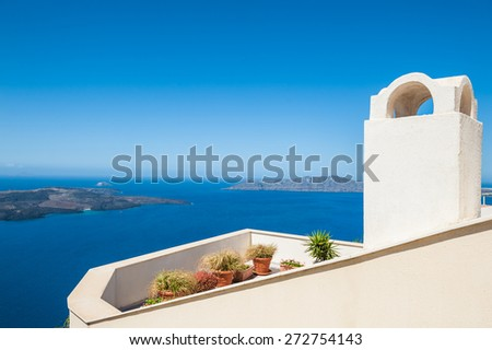 Beautiful view of the sea and islands. Blue sky and blue sea. Santorini island, Greece. - stock photo