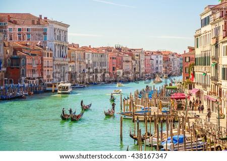 Beautiful view of traditional Gondola on famous Canal Grande with Basilica di Santa Maria della Salute in golden evening light in Venice, Italy - stock photo