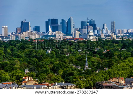 Beautiful view of valley of Seine River and panorama of Paris on backgrounds from lookout near Chateau de Saint-Germain-en-Laye in city Saint-Germain-en-Laye (13 miles west of Paris), France. - stock photo