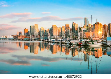 Beautiful view of Vancouver skyline with harbour at sunset, British Columbia, Canada - stock photo