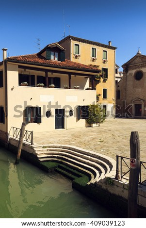 beautiful view of Venice Canal and ancient pier. sunny day landscape with historical houses, traditional church and square. Italy travel destination scenic. famous European Union place - stock photo