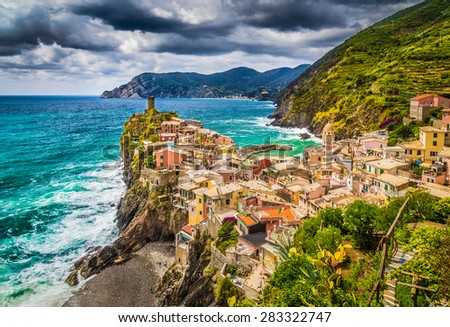 Beautiful view of Vernazza, one of the five famous fisherman villages of Cinque Terre with dark dramatic cloudscape at sunset in Liguria, Italy - stock photo