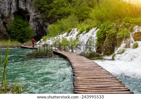 Beautiful view of waterfalls with turquoise water and sunshine in Plitvice Lakes National Park. - stock photo