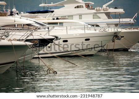 Beautiful view of white luxury yachts and boats moored at sea harbor - stock photo
