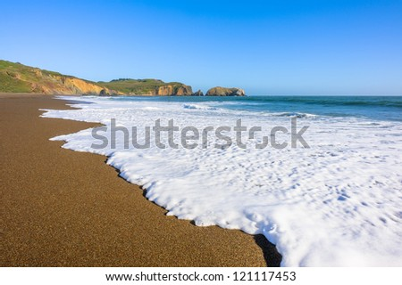 Beautiful view on a wave and ocean wild shore - stock photo