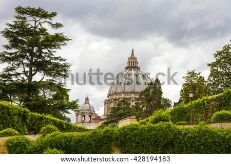 Beautiful view on cupola of Saint Peter basilica (San Pietro) from the garden of the Vatican Museum - stock photo