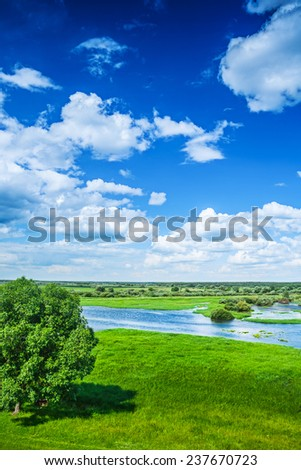 Beautiful view on flood field with blue cloudy sky in spring instagram stile - stock photo