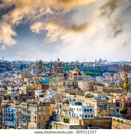beautiful view on houses and roofs of Valletta at sunset in Malta from high - stock photo