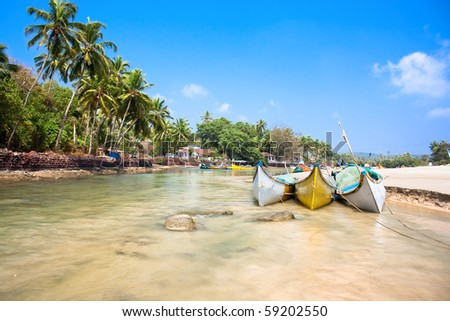 Beautiful view on small indian river with wooden outrigger fishing boats at Baga Beach, Goa, India - stock photo