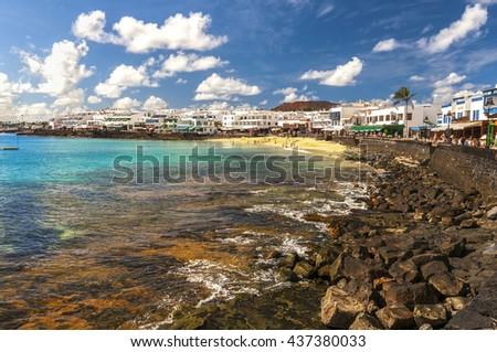 Beautiful view on the Atlantic Ocean on the island of Lanzarote in the village Playa Blanca / View of the promenade in Playa Blanca. Lanzarote. Canary Islands - stock photo