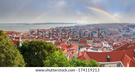 Beautiful view over the city of Lisbon, Portugal, with a rainbow - stock photo