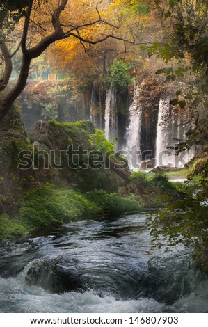 Beautiful view with the waterfall in the forest - stock photo
