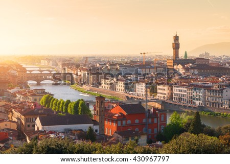 Beautiful views of Florence cityscape in the background Ponte Vecchio bridge at sunset in Italy, Europe - stock photo
