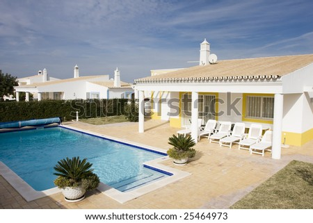 Beautiful villa with pool - typical architecture from Algarve, south of Portugal - stock photo