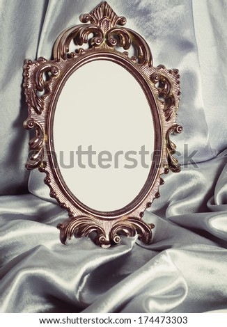 Beautiful vintage frame is a silver silk - stock photo