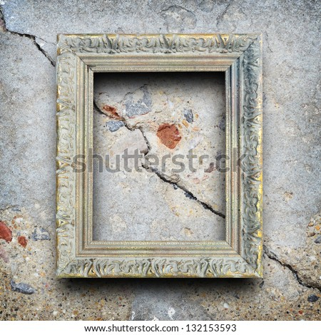 Beautiful vintage frame on cracked cement wall background. - stock photo