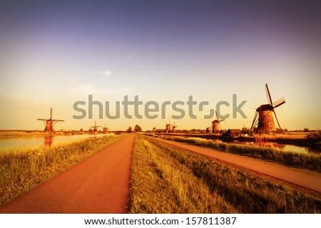 Beautiful vintage image of the dutch windmills at Kinderdijk in the Netherlands. An UNESCO world heritage site - stock photo