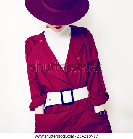 Beautiful vintage lady fashionable style in a red cloak and hat - stock photo