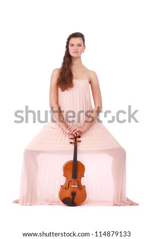 Beautiful violinist posing with her violin isolated on white background - stock photo