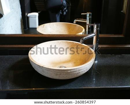 Beautiful washbasin in the bathroom photographed closeup - stock photo