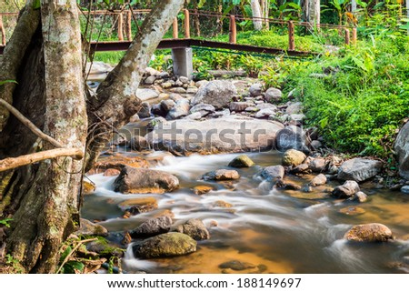 Beautiful water flowing with bridge in nature, Thailand - stock photo