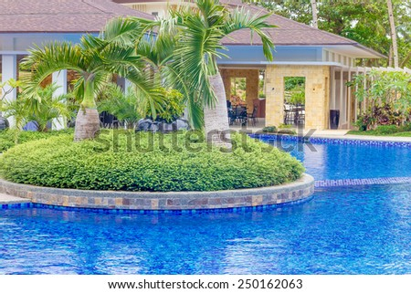 beautiful water pool in tropical hotel, summer vacation image - stock photo